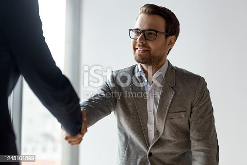 843963182 istock photo Sales manager greets client starts meeting in office 1248161399