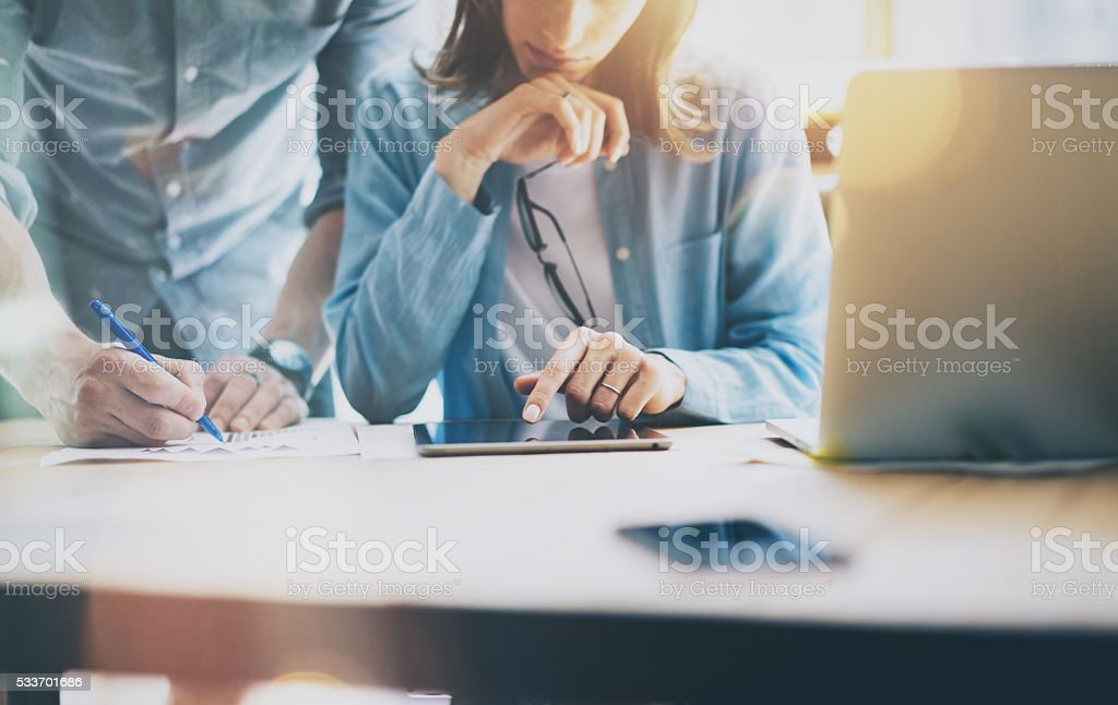 Sales Managers Working Modern Loft.Woman Showing Market Report Digital stock photo