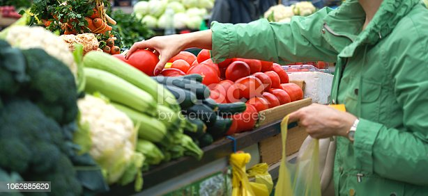 Sales of fresh and organic fruits and vegetables at the green market or farmers market. Citizens buyers choose and buy products for healthy food