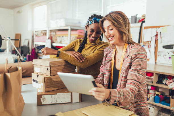Sales Online. Working women at their store. stock photo