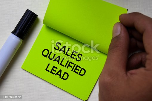 520244535 istock photo Sales Qualified Lead - SQL text on sticky notes isolated on office desk 1167539572