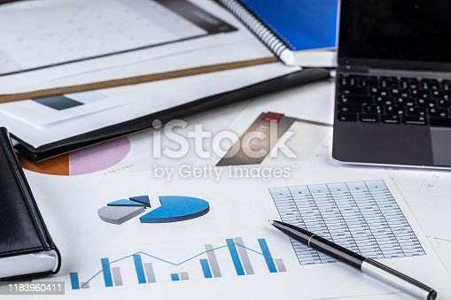 Sales, report, laptop, pen, diagram