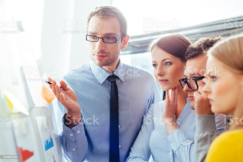 Sales representatives analysing their results stock photo