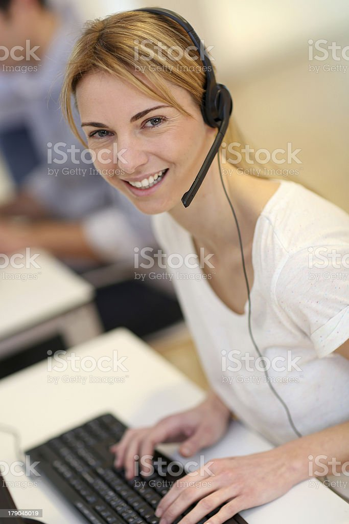Sales service operator with computer stock photo