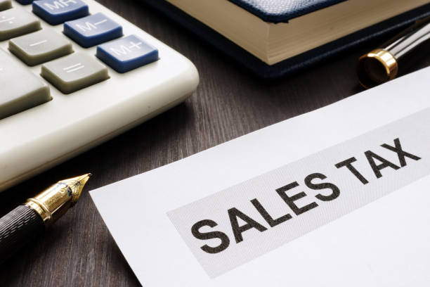Sales tax. Papers on the office table. stock photo