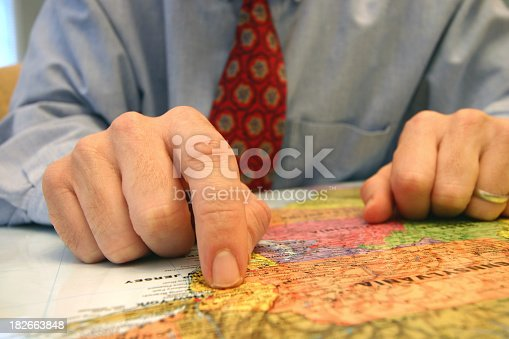 a business executive looking at a map of new york