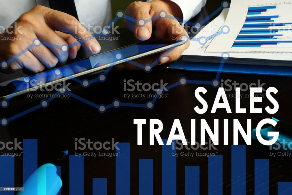 Sales training concept. Manager is holding tablet. stock photo