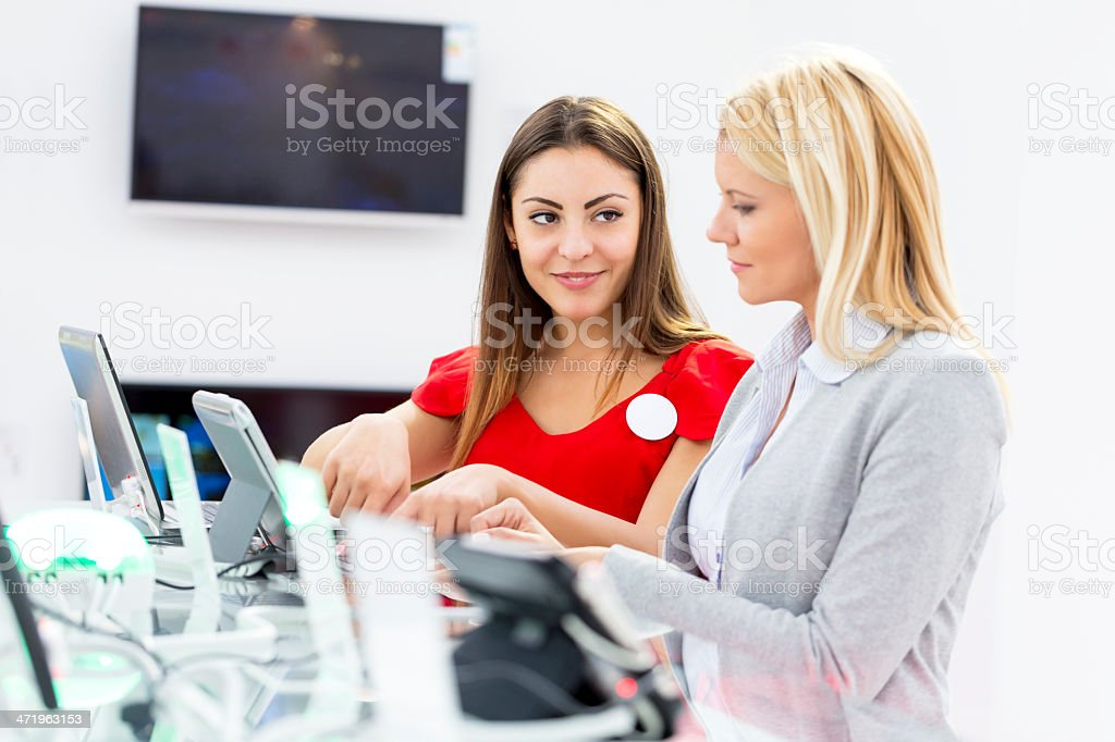 A sales woman talking about the computers royalty-free stock photo