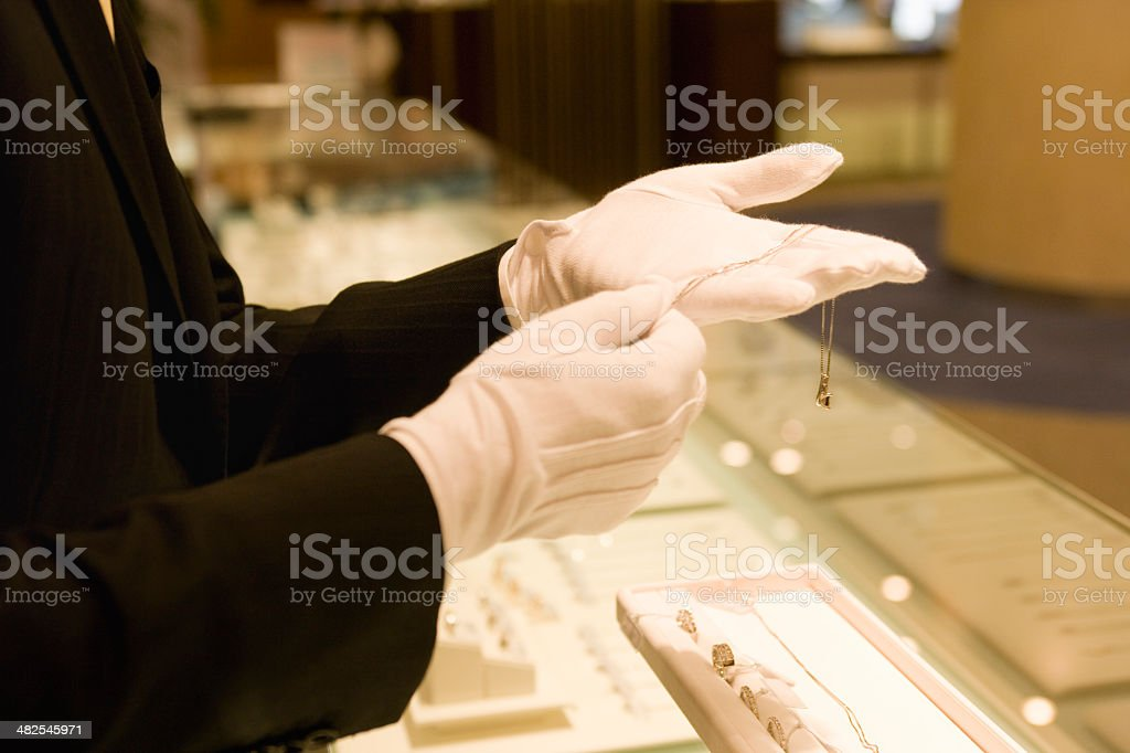 Salesclerk taking care of customers at jewerly shop stock photo
