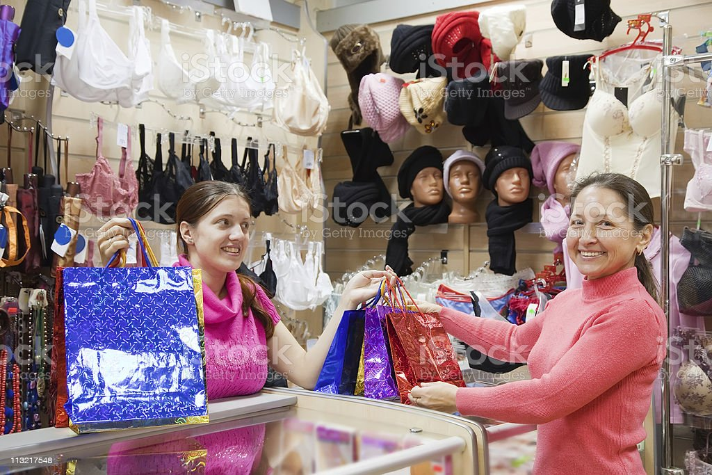Salesman and buyer with purchases at  counter stock photo