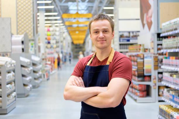 salesman at construction super store - supermarket worker imagens e fotografias de stock