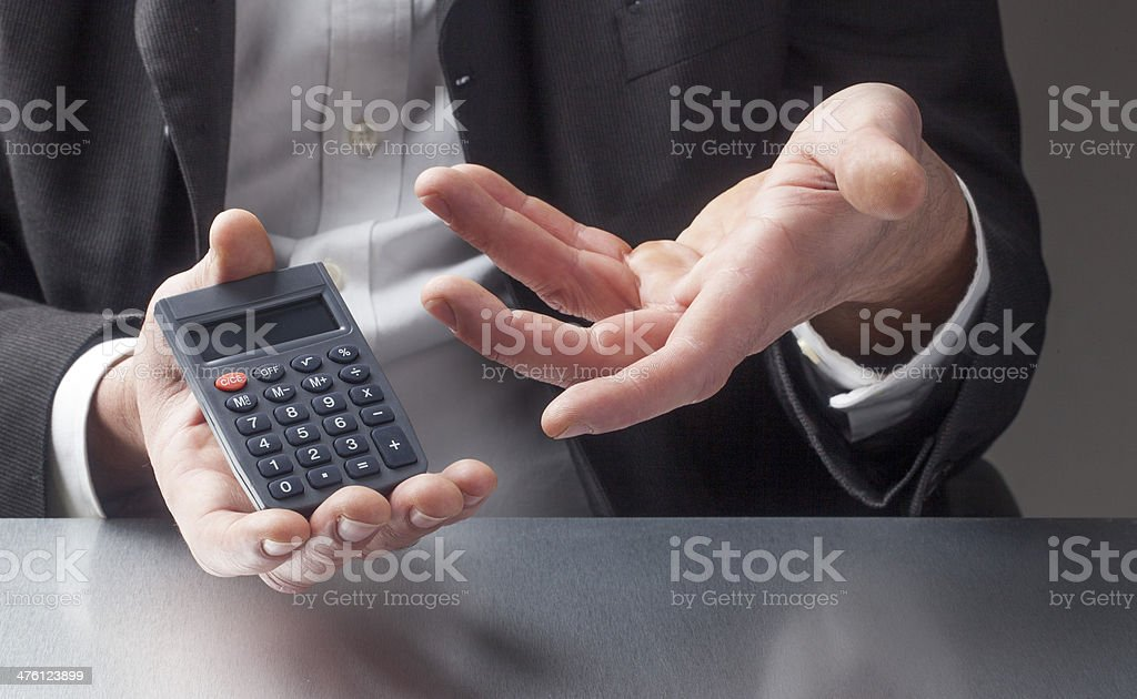 salesman gestures to save money royalty-free stock photo