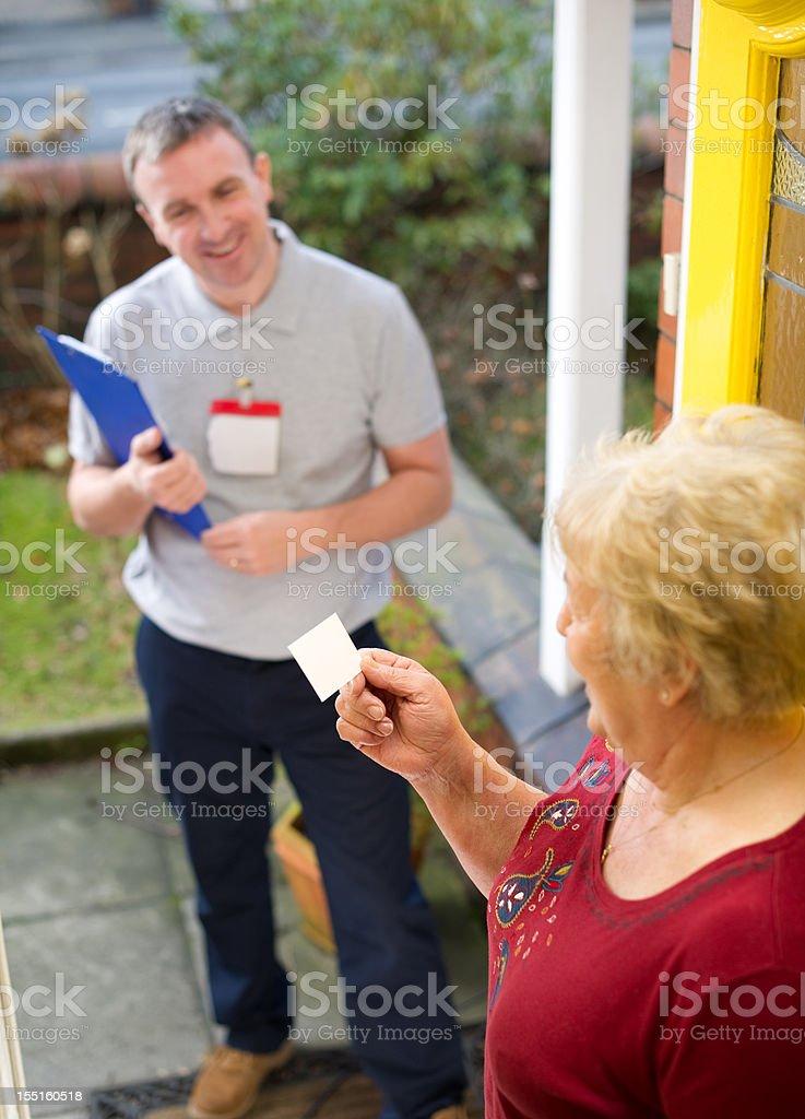 Salesman giving woman his card stock photo