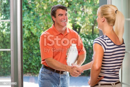 istock Salesman Greeting Housewife 180723880