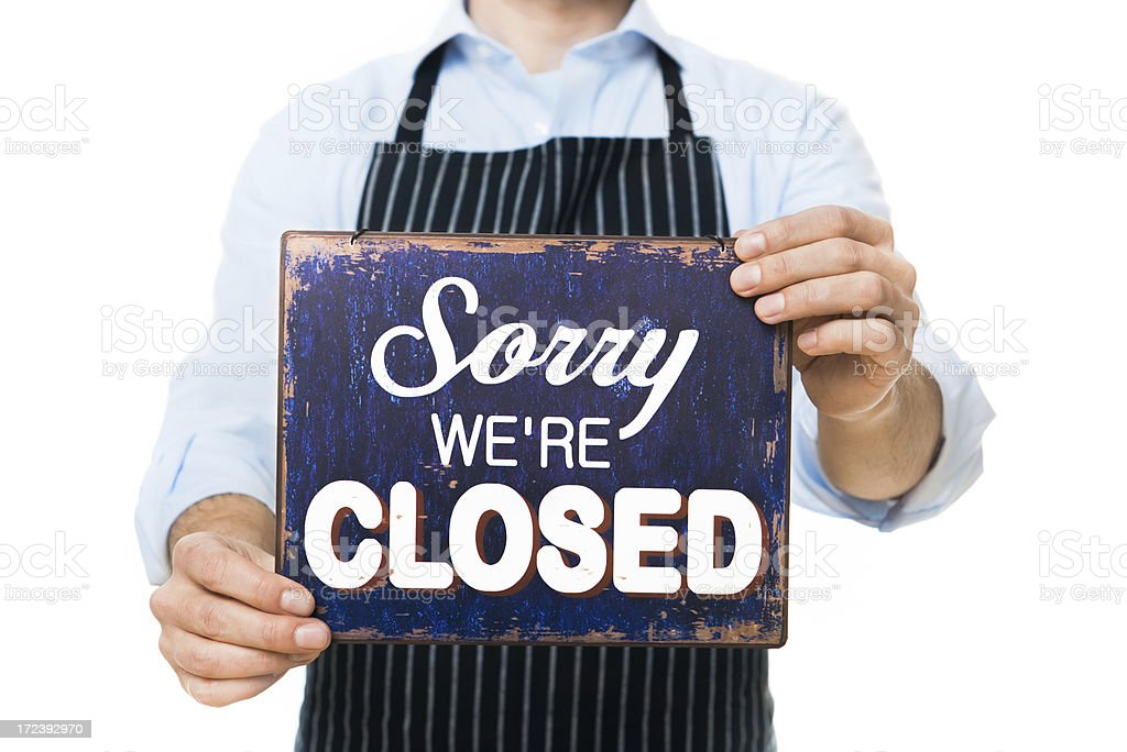 Salesman Holding CLOSED Sign royalty-free stock photo
