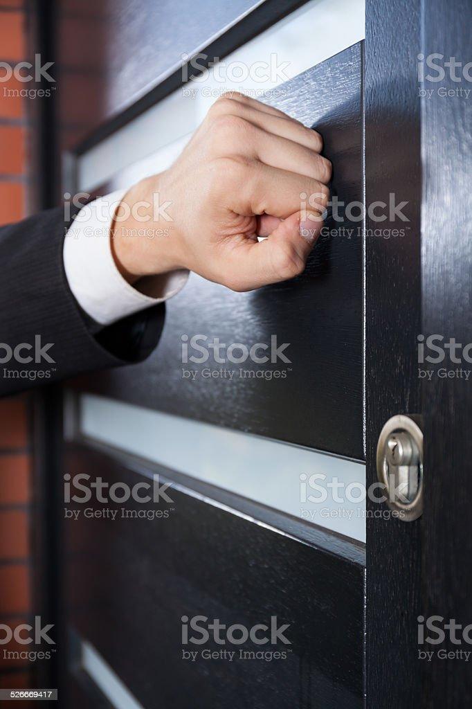 Salesman knocking on the door stock photo