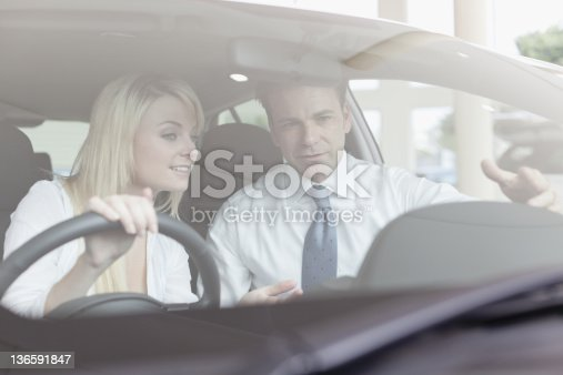 136591850 istock photo Salesman showing car to customer 136591847