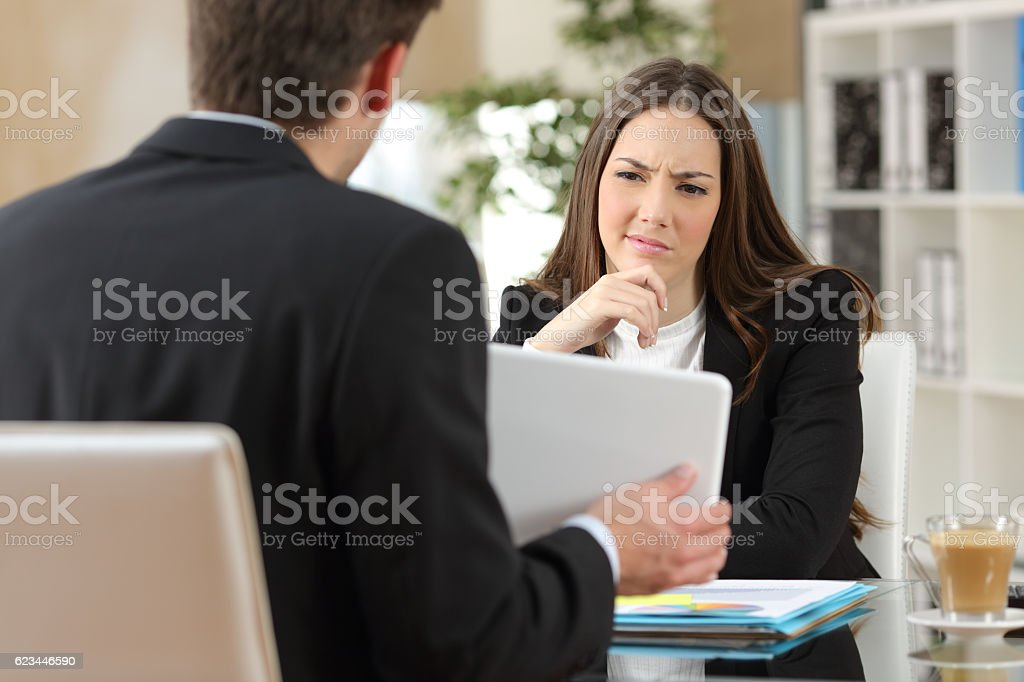 Salesman trying to convince a doubtful customer stock photo