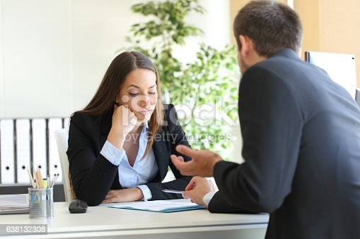 istock Salesman trying to convince to a bored client 638132308