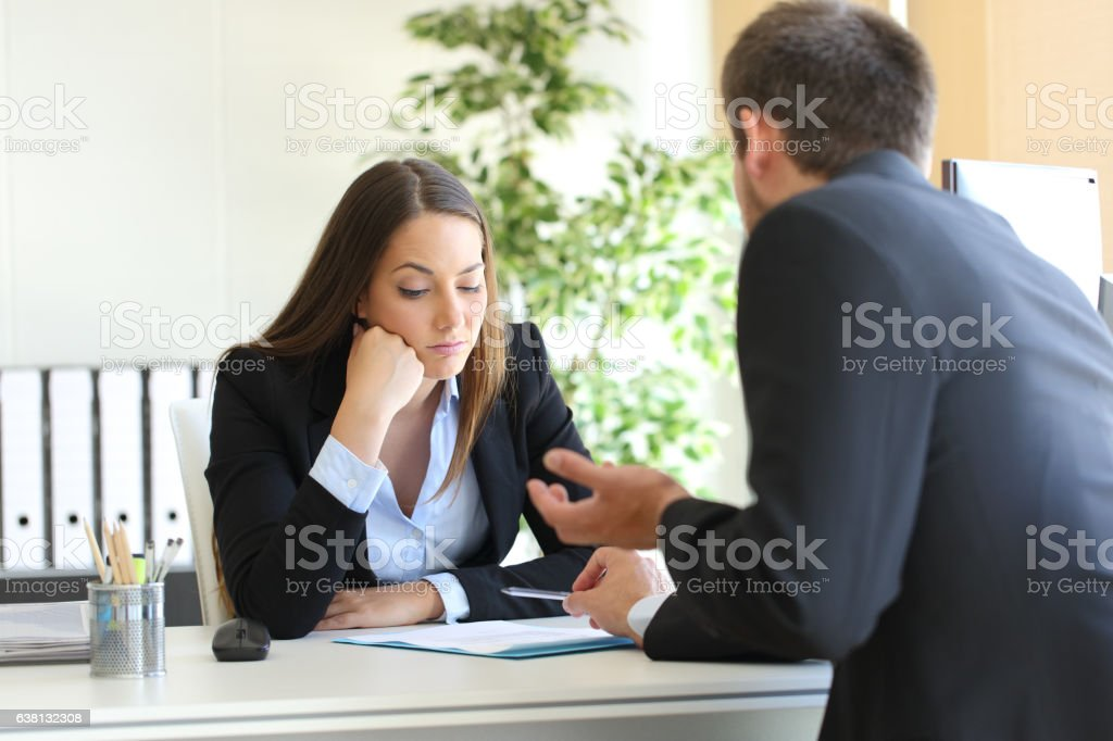 Salesman trying to convince to a bored client stock photo