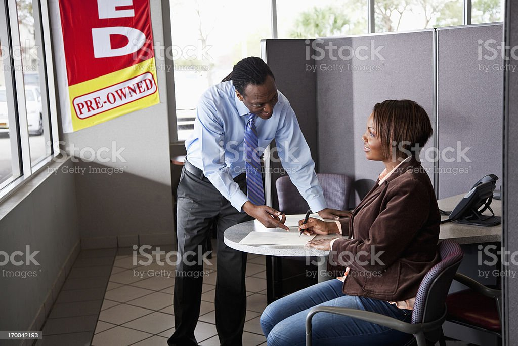 Salesman with customer buying used car royalty-free stock photo