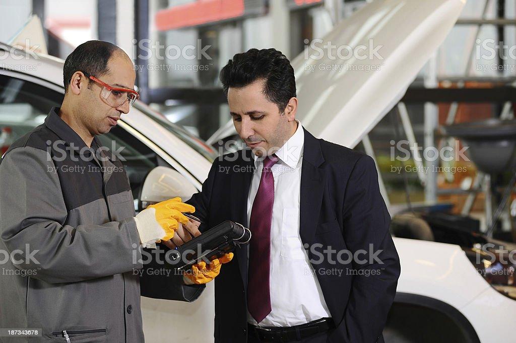 Salesman with mechanic stock photo