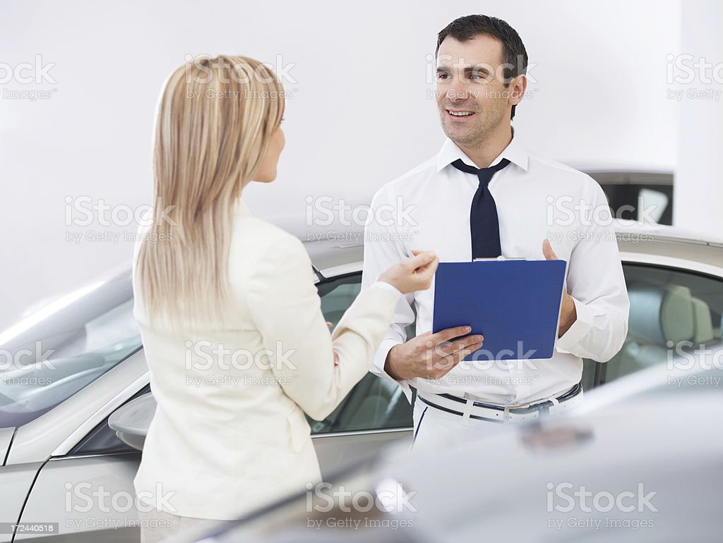 Salesperson explaining details of the contract royalty-free stock photo