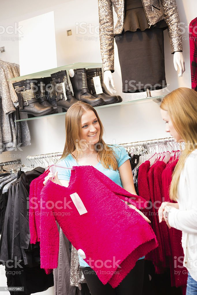 salesperson talking to customers in fashion store royalty-free stock photo