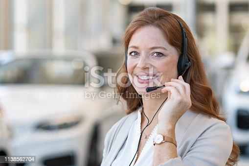 istock Saleswoman at call center of car dealership 1138562704