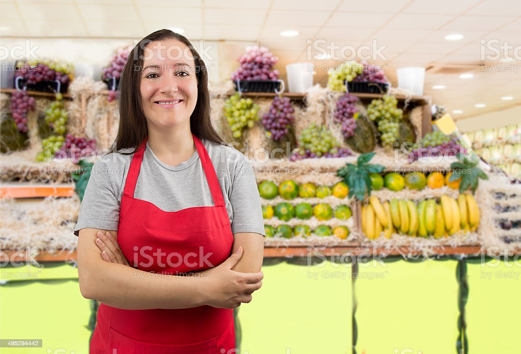 saleswoman at the greengrocer stock photo