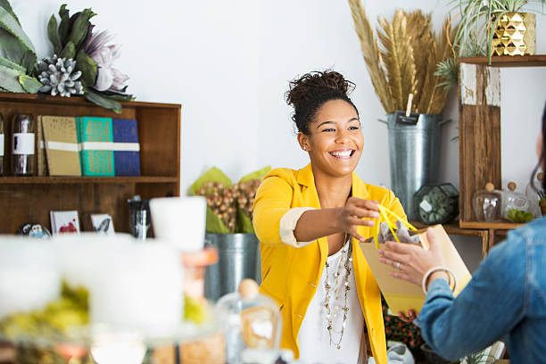 Saleswoman helping customer stock photo