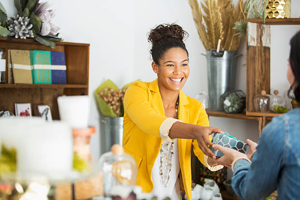 Saleswoman helping customer stock photo