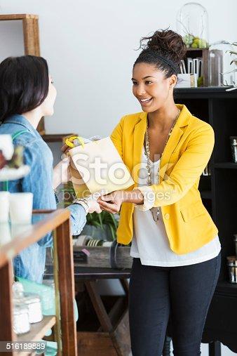 istock Saleswoman helping customer 516189889
