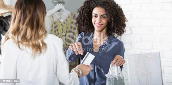istock Saleswoman in boutique 505890107