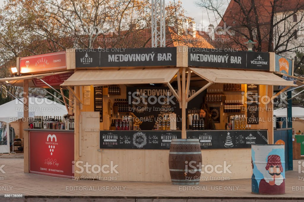 Saleswoman in stall with bee products at Christmas market stock photo