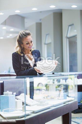 478253473istockphoto Saleswoman working in jewelry store 856749896