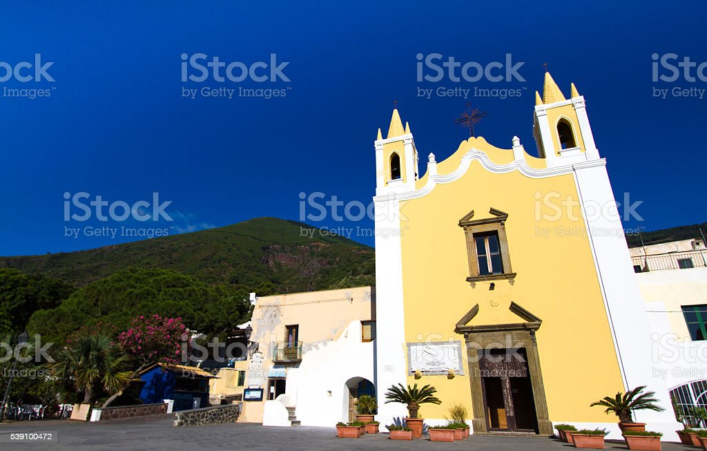 Salina, Sicily: Bright Yellow Church of Maria Ss Addolorata stock photo