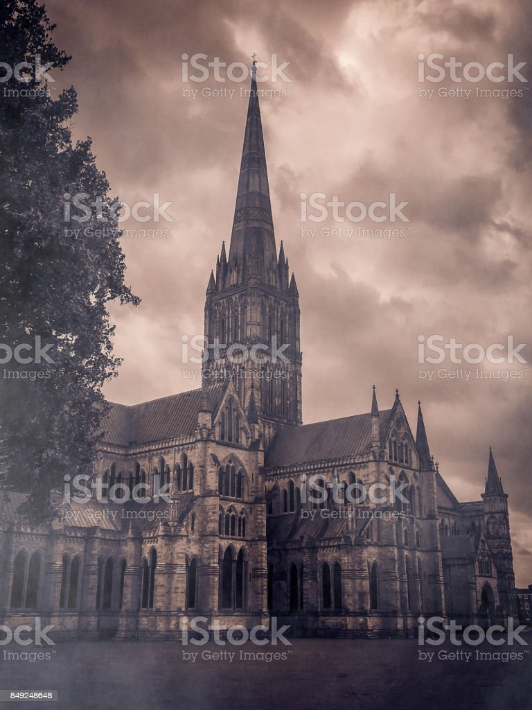 Salisbury cathedral in the fog, mystique atmosphere stock photo