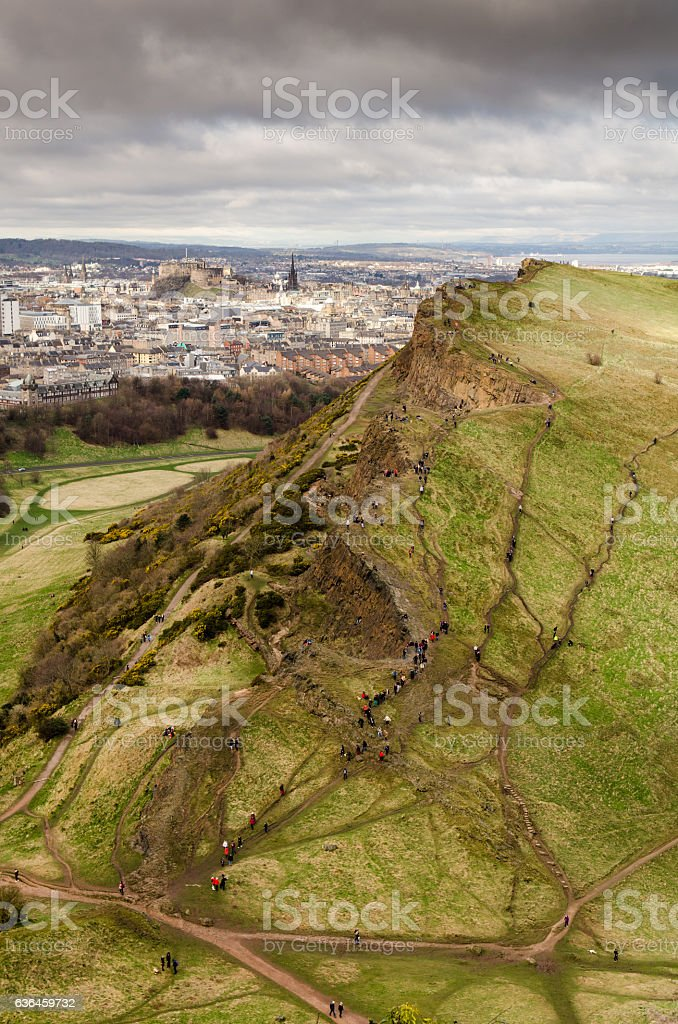 Salisbury Crags and Edinburgh cityscape stock photo