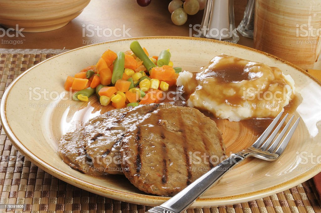 Salisbury steak dinner with mixed vegetables stock photo