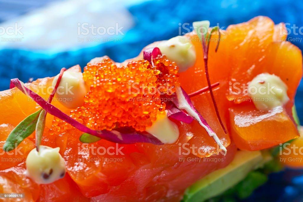 Salmon and avocado Tartare with soya stock photo