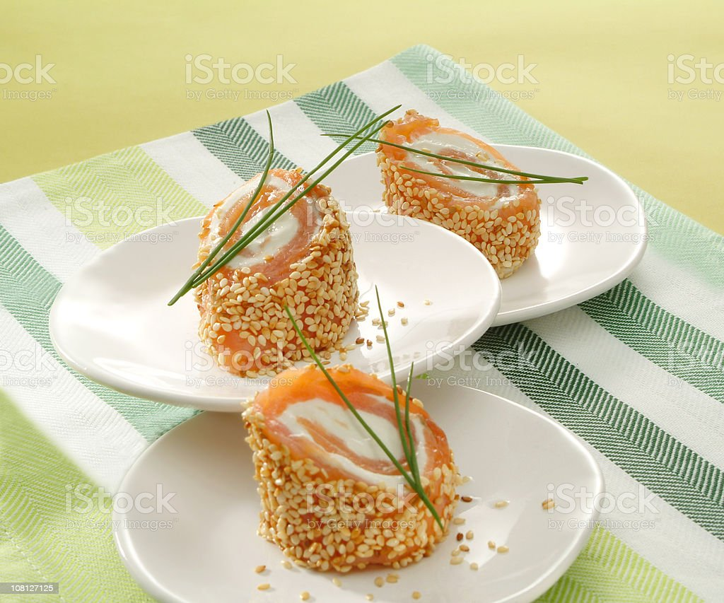 Salmon and Cream Cheese Rolls in Sesame Seeds royalty-free stock photo