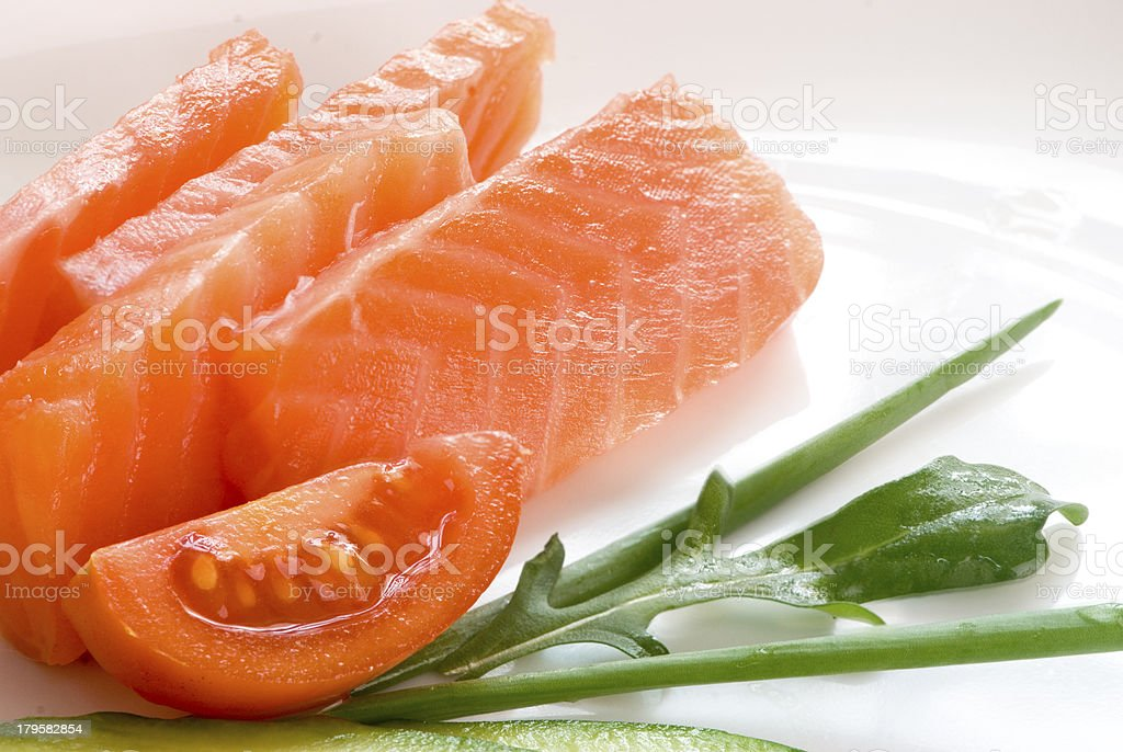 salmon and onion on the white plate royalty-free stock photo