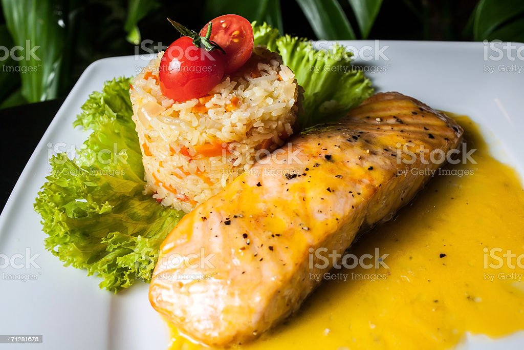 Salmon and Pilaf with the tomato stock photo