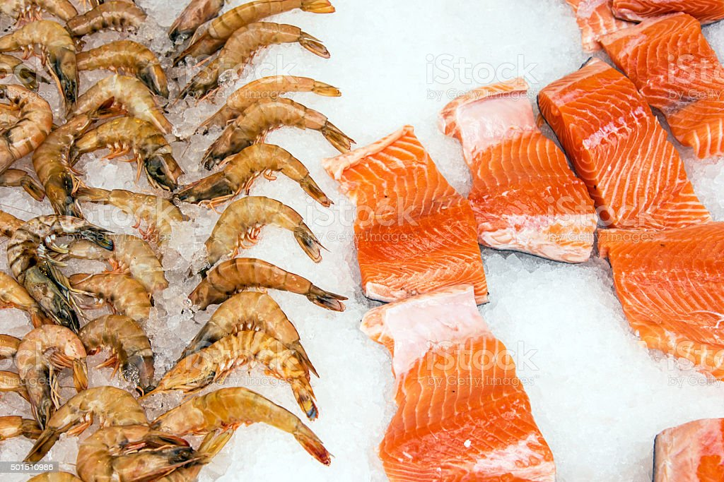 Salmon and shrimps at a market stock photo