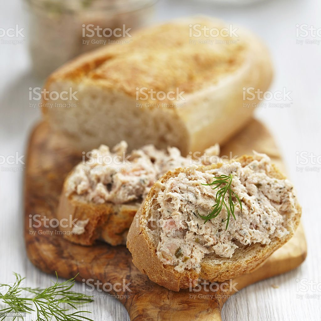 Salmon and soft cheese spread on bread stock photo