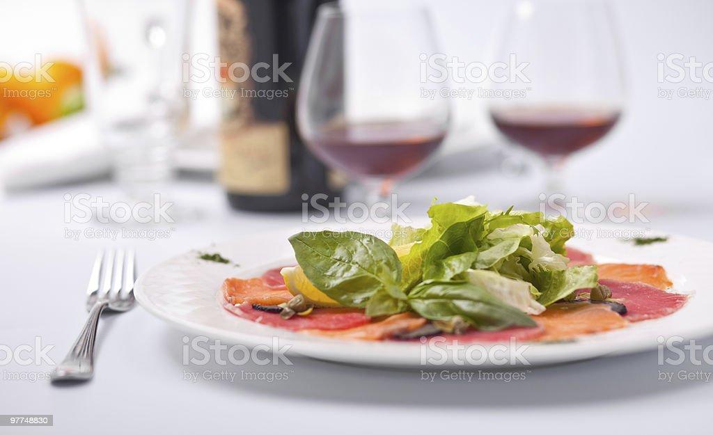 Salmon and tuna Carpaccio with Greens, Lemon. royalty-free stock photo