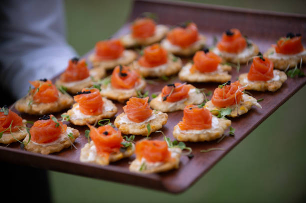 Salmon Appetisers canapes ready to be served closer stock photo