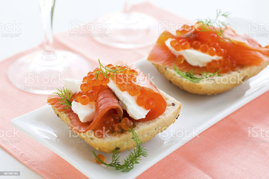 salmon appetizer with red caviar royalty-free stock photo