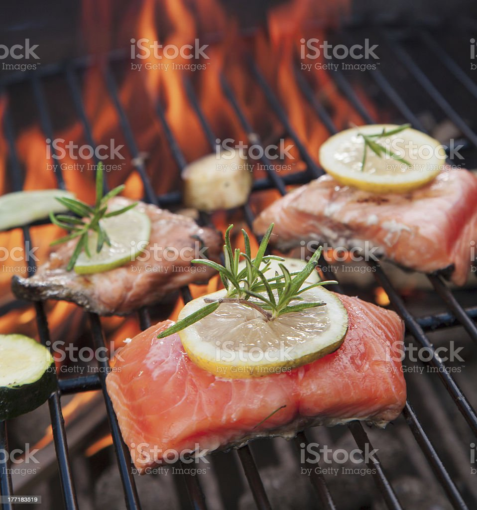 Salmon being grilled on the barbecue stock photo